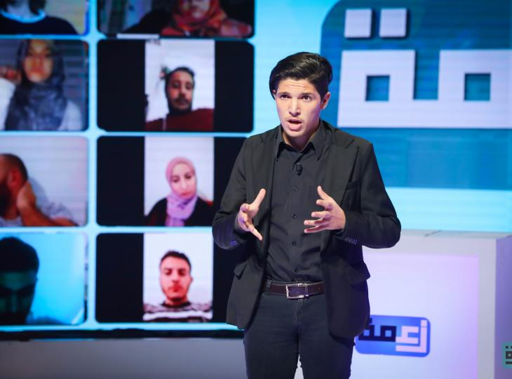 Young man in a televised debate in Tunisia